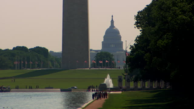ms washington monument, capitol building in background, washington dc, usa - washington monument washington dc stock videos & royalty-free footage