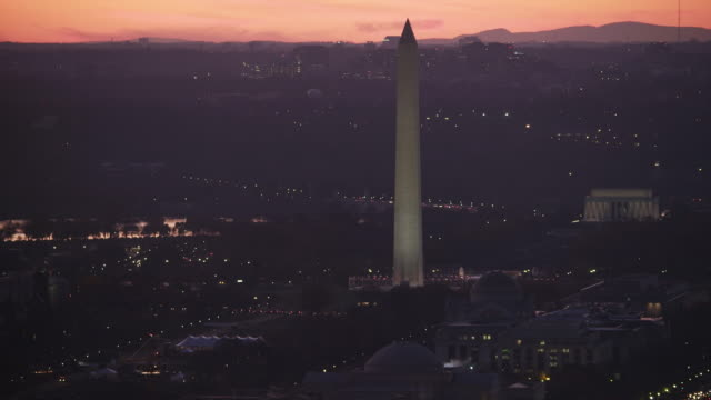washington monument dominating washington dc cityscape at dusk; lincoln memorial in rear, national gallery of art in foreground. shot in 2011. - artbeats stock videos & royalty-free footage