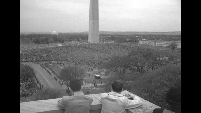 ws washington monument with immense crowd on the national mall tilt down to two young men looking on from terrace of building / ls us marine corps... - united states congress video stock e b–roll