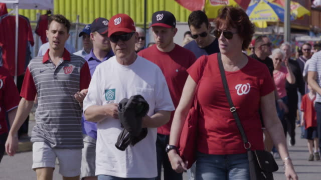washington nationals fans entering nationals park - nationals park stock videos & royalty-free footage
