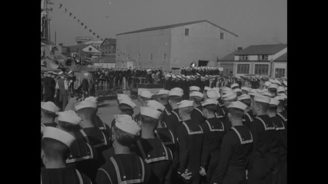 sailors in formation for ceremony on pier beside submarine / car arrives Secretary of Navy James Forrestal gets out greets officers / WS ceremony on...