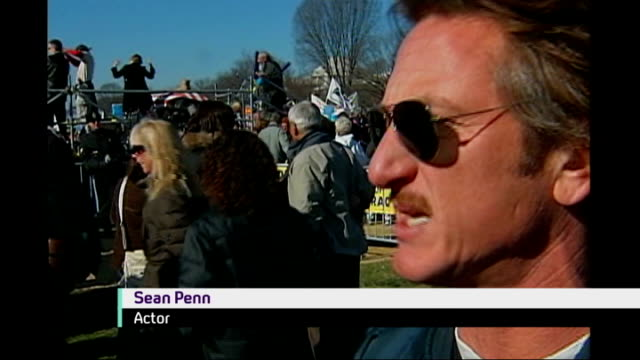 vídeos y material grabado en eventos de stock de protests over war in iraq sean penn interview sot on aims of the protest / to show the world that in a democracy the people can be the deciders - sean penn