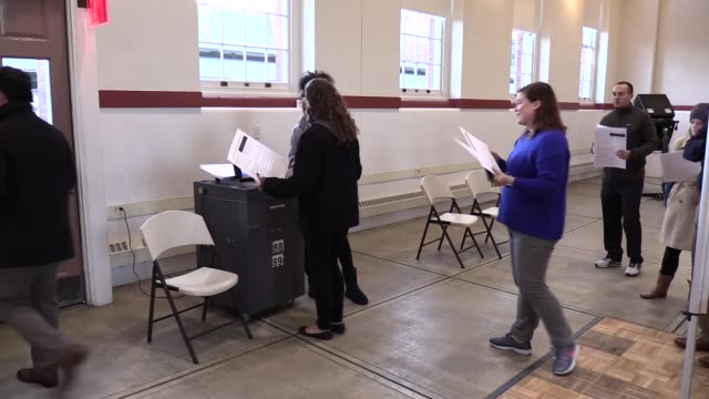 stockvideo's en b-roll-footage met washington residents cast their ballots at eastern market polling station on november 08 2016 in washington americans across the nation are picking... - stembus