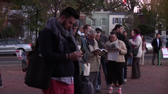 stockvideo's en b-roll-footage met washington residents go to the polls at eastern market polling station on november 08 2016 in washington americans across the nation are picking... - stembus