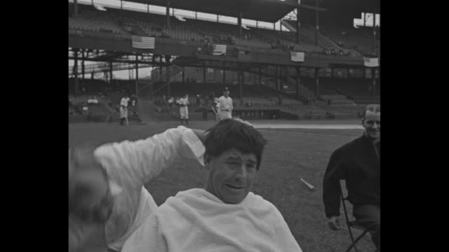 washington senators coach nick altrock wearing bald cap sunglasses and holding cigar in mouth comedically plays role of barber on baseball field... - shaving brush stock videos & royalty-free footage