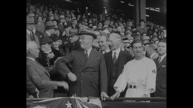 ws washington senators stand before presidential box on opening day / president franklin d roosevelt laughs and jokes with philadelphia athletics... - president stock videos & royalty-free footage