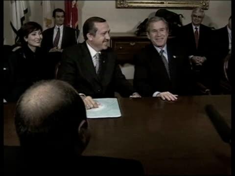 washington: the white house: int turkish leader tayyip erdogan sat with president george w bush zoom in erdogan greeted as into room - recep tayyip erdoğan stock videos & royalty-free footage
