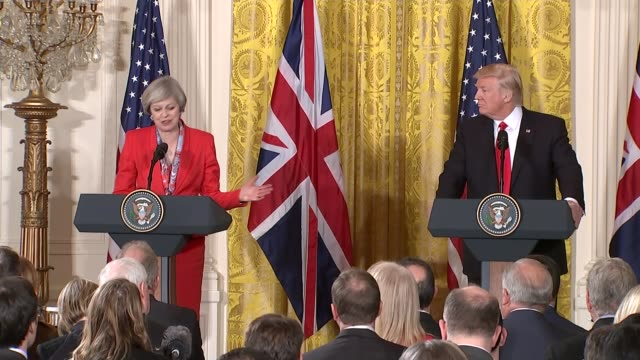 washington white house ext donald trump and theresa may mp walking along white house colonnade together holding hands at one point/ donald trump... - waterboarding stock videos & royalty-free footage