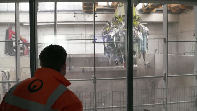 waste being used to provide heat and electricity at a plant in leeds - construction vehicle stock videos & royalty-free footage