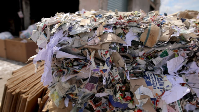 waste cardboard and paper is collected and packed for recycling. dump of old stacked cardboard box.recycling center collects paper and carton boxes - cardboard box stock videos & royalty-free footage