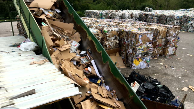 waste compactor on a dumpsite - garbage disposal stock videos and b-roll footage