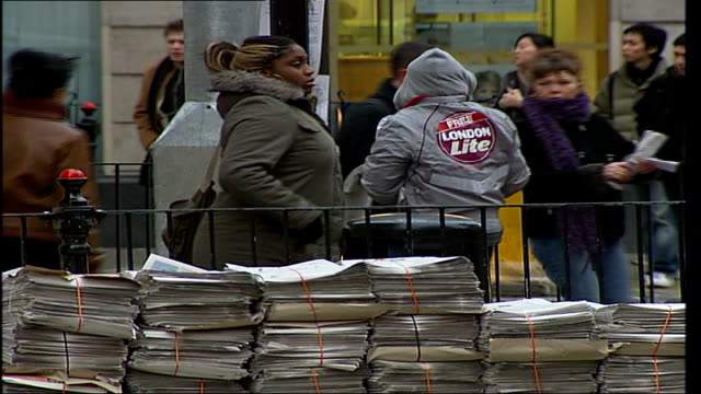 westminster council threatens to ban free newspapers central london stacks of newspapers piled up next to railing as 'london lite' distributor hands... - disposal stock videos and b-roll footage