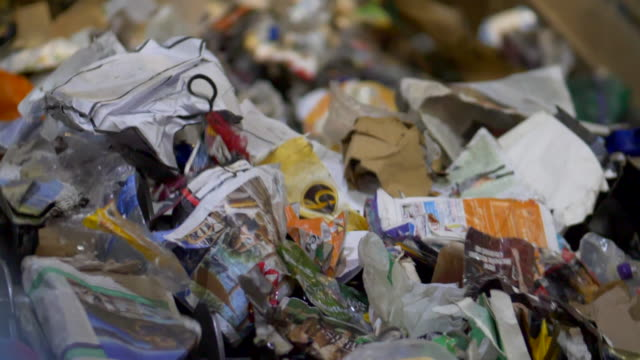 waste management centre recycling conveyor belt with plastics rubbish bottles and paper waste - decline stock videos & royalty-free footage