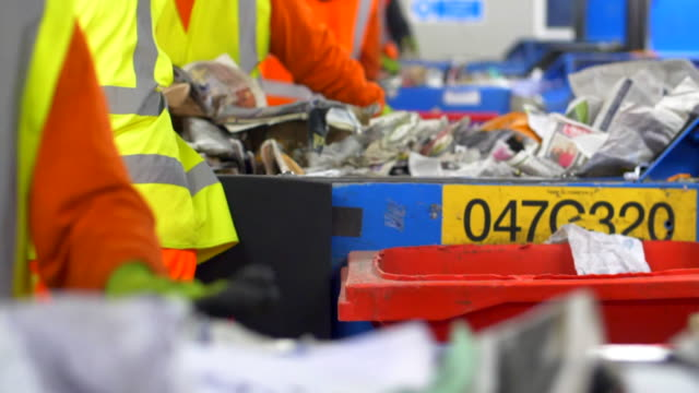 waste management centre workers sort recycling rubbish plastics and waste on conveyor belts - recycling stock videos & royalty-free footage