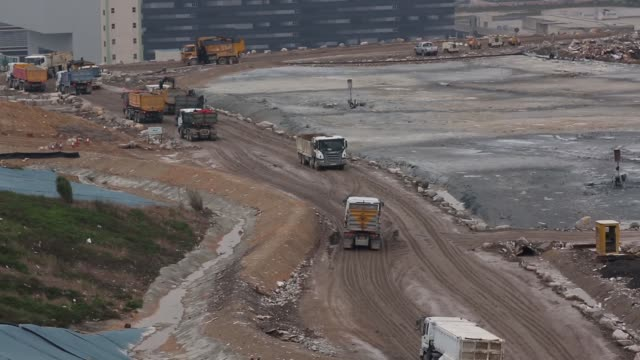waste management trucks drive through the south east new territories landfill site in the tseung kwan o area of hong kong landfill waste site in hong... - china east asia stock videos & royalty-free footage