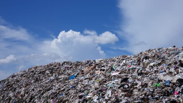 waste mountain with cumulus clouds - time lapse 4k - landfill stock videos & royalty-free footage