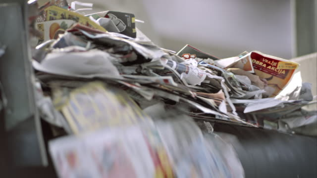 ld waste paper falling off the conveyor belt - paper stock videos & royalty-free footage