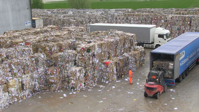 ms pan waste paper storage yard at paper mill / weener, lower saxony, germany - wastepaper bin stock videos & royalty-free footage