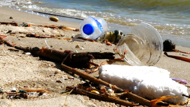 waste pollution on beach , zoom in - garbage stock videos & royalty-free footage