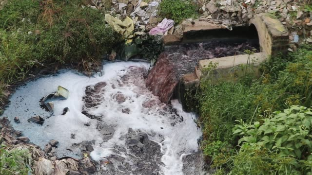wastes released by textile industries in savar flow into the dhaleswari river in dhaka . - dhaka stock videos & royalty-free footage