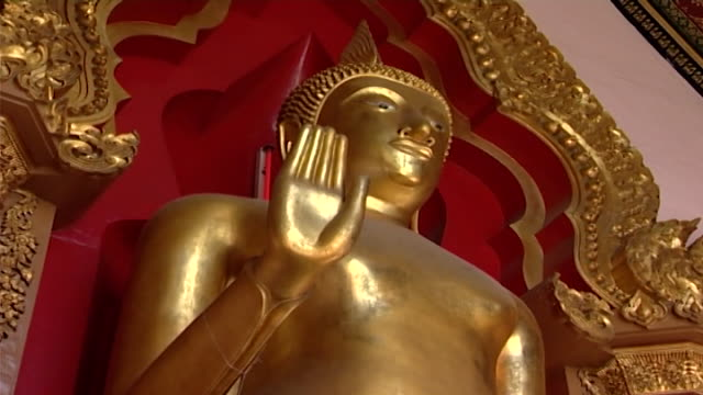 wat phra pathom chedi lowangle shot of a phra ruang rodjanarith buddha statue standing in abhaya mudra a posture believed to dispel fear and anger - mudra stock videos & royalty-free footage