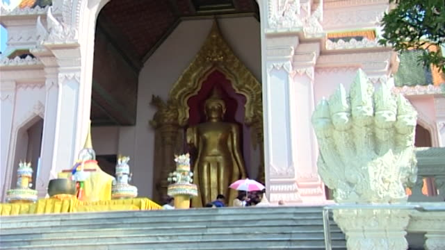 wat phra pathom chedi. the phra ruang rodjanarith buddha statue housed beneath a rattanakosin-influenced portico. - pagoda stock videos & royalty-free footage