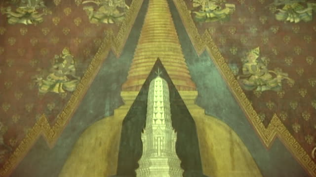 wat phra pathom chedi. tilt-down over a mural depicting the temple with its tall stupa and prang. - pagoda stock videos & royalty-free footage