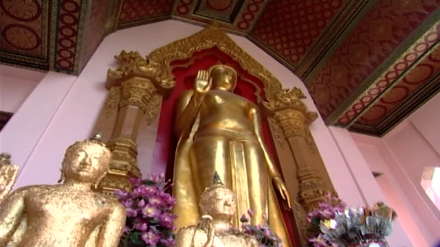 wat phra pathom chedi tiltup from a phra ruang standing buddha statue in abhaya mudra to an ornate ceiling decorated with lotus flower motifs - aquatic plant stock videos & royalty-free footage