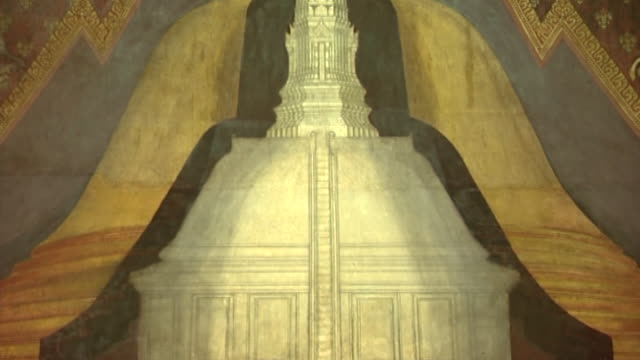 wat phra pathom chedi. tilt-up over a mural depicting the temple with its tall stupa and prang. - pagoda stock videos & royalty-free footage