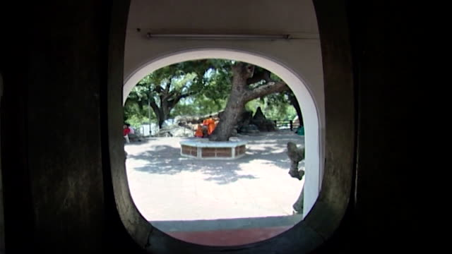 wat phra pathom chedi. view of thai child novices sitting under a tree while bells toll. they are called samanera and their vows are temporary. - pagoda stock videos & royalty-free footage