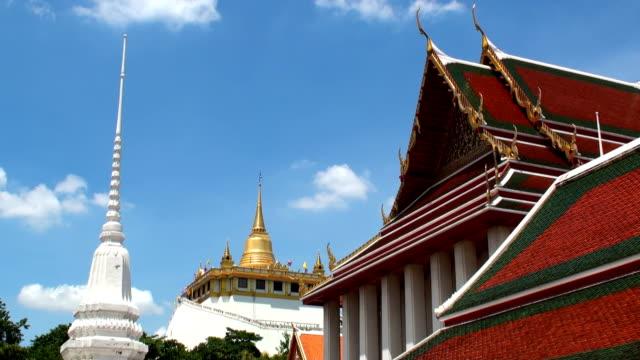 ワットサケットとゴールドの実装-バンコク,タイ - 金箔点の映像素材/bロール