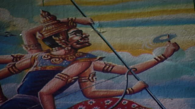 wat suan dok temple. a painting depicting a manifestation of mara, a demon wielding weapons with its six arms. - cross legged stock videos & royalty-free footage