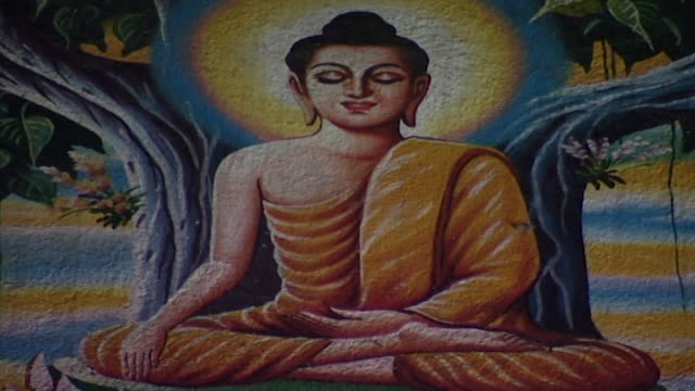 wat suan dok temple cu of a painting depicting buddha in the bhumisparsha mudra pose whilst seated on a lotus flower beneath the bhodi tree - cross legged stock videos & royalty-free footage
