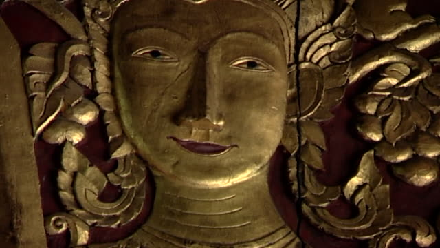 wat suan dok temple cu of an ornately carved golden relief of prince siddhartha gautama wearing an elaborate headdress - headdress stock videos & royalty-free footage