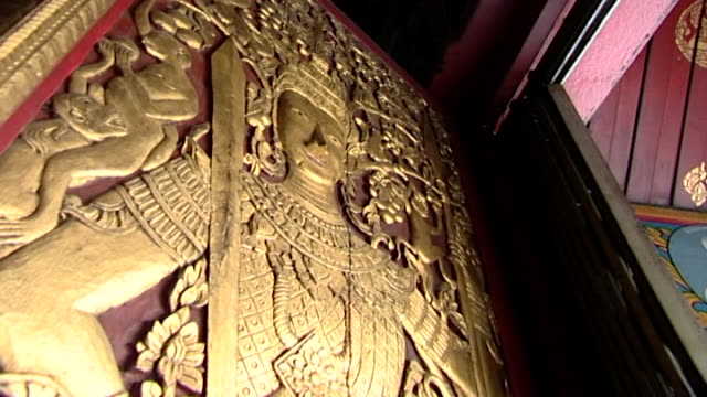wat suan dok temple. low-angle of an intricately carved, golden relief of prince siddhartha, the future buddha, wearing an elaborate headdress. - headdress stock videos & royalty-free footage