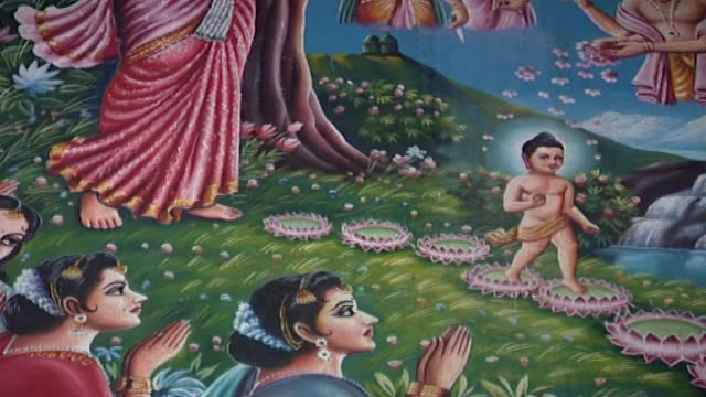 wat suan dok temple tiltup from a mural of the baby buddha creating lotus flowers at his first steps to his mother queen maya and deities - aquatic plant stock videos & royalty-free footage