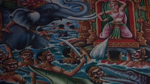 wat suan dok temple. view of a painting depicting the manifestations of mara, a demon who tried to seduce buddha with visions of beautiful women. - cross legged stock videos & royalty-free footage