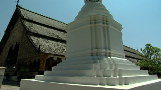 wat suan dok temple. view of the base of one of the mausoleums that contain the ashes of chiang mai's royal family. - temple building stock videos & royalty-free footage