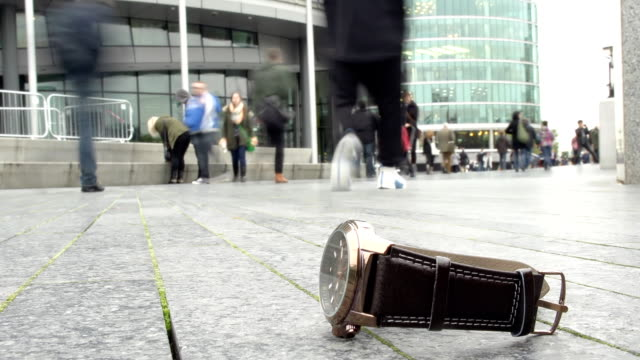 HD TIME-LAPSE: Watch Laying On Pedestrian Walkway