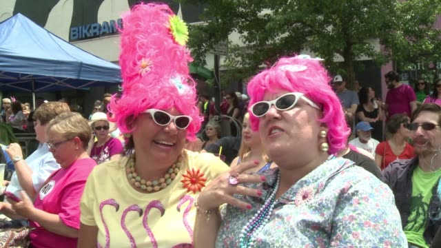 watch out for that beehive baltimore maryland is swarming with bee hive hairdos cat eye glasses and anything with a leopard print at honfest an... - cat's eye glasses stock videos and b-roll footage