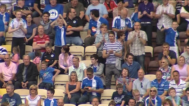 watch the action as wigan athletic play a pre-season friendly against preston north end in july 2011 football fans at deepdale on september 22, 2011... - lancashire stock videos & royalty-free footage