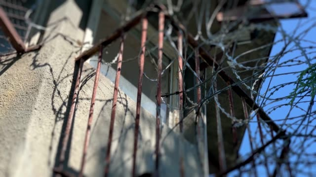 watch tower in old city prison with concertina - prison wall stock videos & royalty-free footage