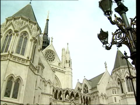 watchdog criticises new antiterror bill date gvslaw courts gvs old bailey 'scales of justice' statue - equal arm balance stock videos and b-roll footage