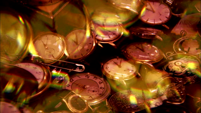 Watches fill a glass case. Available in HD.