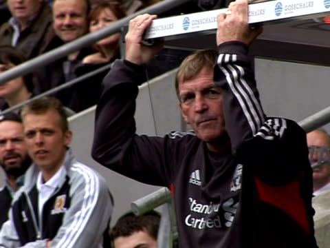 watches his team play Hull City from the dugout during a preseason friendly in July 2011 Liverpool FC Manager Kenny Dalglish at Anfield on September...