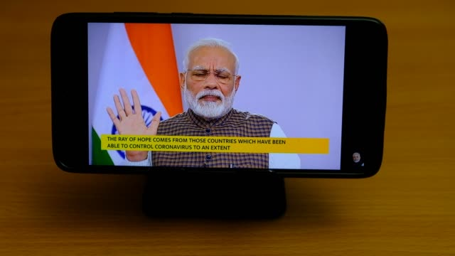 watching on a mobile phone, the speech being broadcasted live via internet. the announcement affects the entire 1.3 billion population of india, the... - announcement message stock videos & royalty-free footage