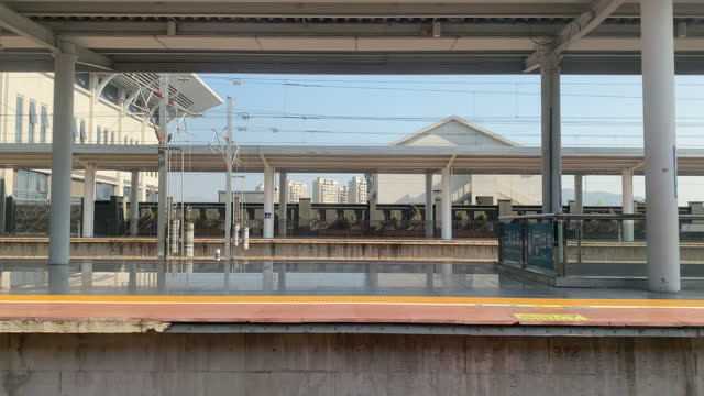 watching the high-speed train slowly enter the platform - abstract stock videos & royalty-free footage