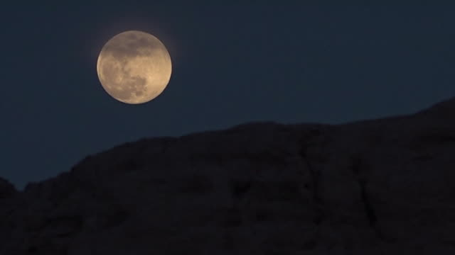 watching the moon slowly rise in uzbekistan - the past stock videos and b-roll footage