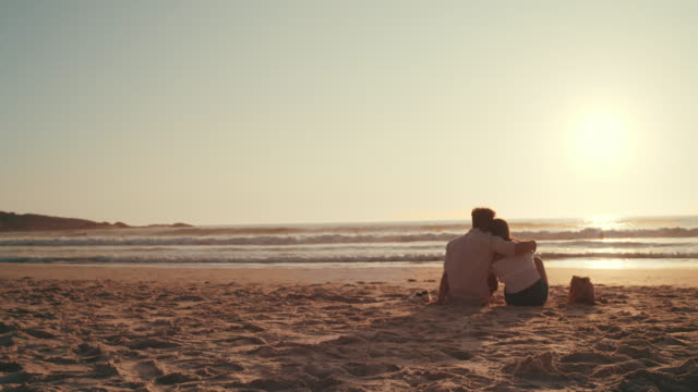 watching the sunset with my special someone - falling in love stock videos & royalty-free footage