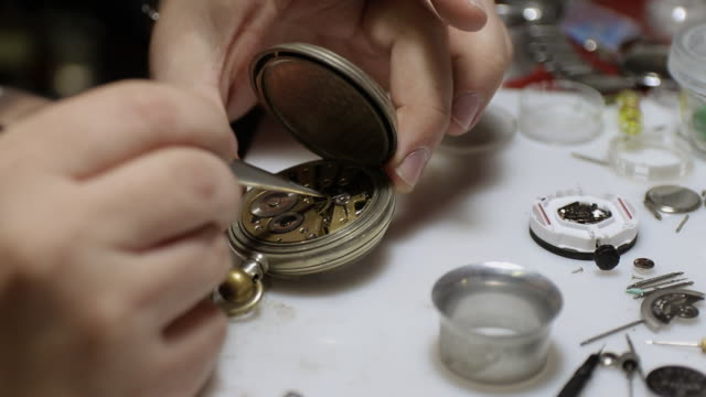 watchmaker assembling old fashioned pocket watch at workshop - pocket watch stock videos & royalty-free footage